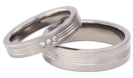 Titanium wedding ring with the cubic zirconias SWT-3/4-k